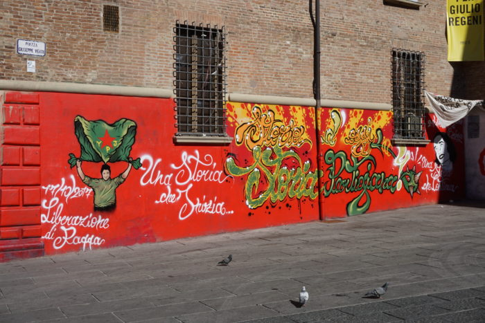 Political street art in Piazza Verdi
