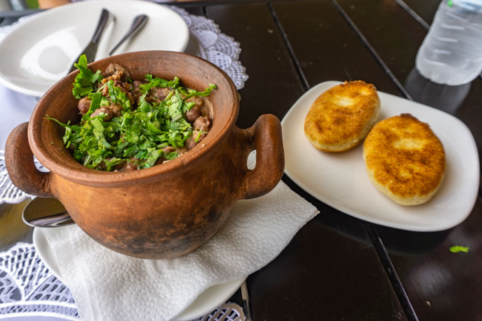 Lobio served in a traditional pot with cornbread