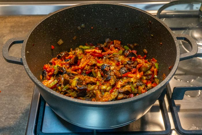 Adding in the peppers and chilli to this Georigan eggplant stew