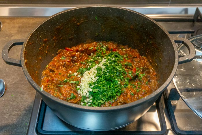 Add in the garlic and cilantro to this ajapsandali recipe