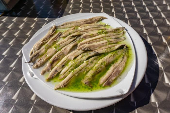 You can find boquerones en vinagre in Malaga or Seville or Valencia