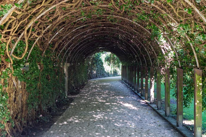 Iconic archway featured in The Sound of Music in Mirabell Gardens